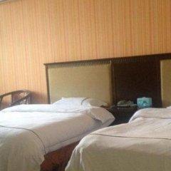 Отель Zhongshan Guzhen Yuyuan Business Inn комната для гостей фото 3