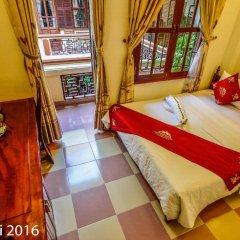 Отель Nhi Nhi 3* Номер Делюкс фото 6