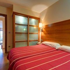 Отель Astuy Apartamentos Арнуэро комната для гостей фото 4