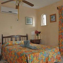 Апартаменты Carib Beach Apartments Negril комната для гостей фото 2