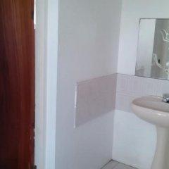 Отель Iron Shore Village ванная