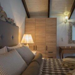 Отель Porto Enetiko Suites Улучшенные апартаменты с различными типами кроватей фото 10