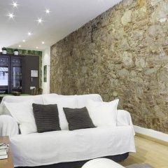 Апартаменты Home Around Gracia Apartments Барселона комната для гостей фото 3