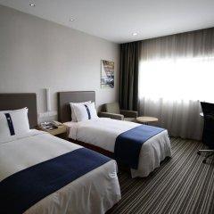 Отель Holiday Inn Express Shanghai New Hongqiao 3* Стандартный номер с различными типами кроватей фото 3