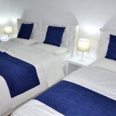 Отель Natea Apartments Албания, Тирана - отзывы, цены и фото номеров - забронировать отель Natea Apartments онлайн комната для гостей фото 3