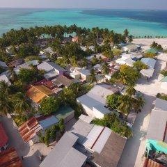 Отель Holiday Mathiveri Inn Мальдивы, Мадивару - отзывы, цены и фото номеров - забронировать отель Holiday Mathiveri Inn онлайн пляж фото 2