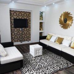 Отель Maximus Apartament Bishkek Кыргызстан, Бишкек - отзывы, цены и фото номеров - забронировать отель Maximus Apartament Bishkek онлайн комната для гостей