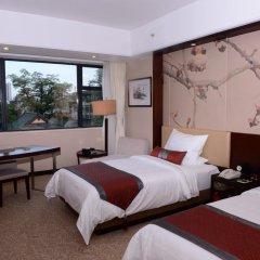 Guangdong Yingbin Hotel 4* Улучшенный номер с 2 отдельными кроватями фото 4