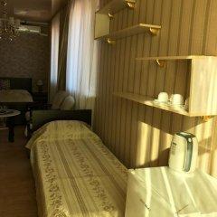Гостиница Сафари Улучшенный семейный номер с разными типами кроватей фото 8