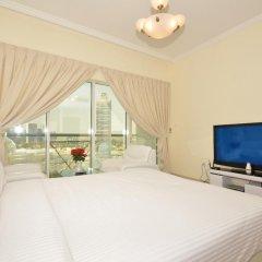 Апартаменты One Perfect Stay Studio Burj Al Nujoom комната для гостей фото 5