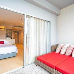Отель Ramada by Wyndham Phuket Deevana Patong Номер Делюкс с двуспальной кроватью фото 14