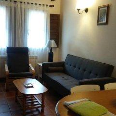 Отель Apartamentos Rurales La Fuente de Báscones комната для гостей фото 5