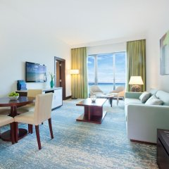 JA Ocean View Hotel 5* Стандартный семейный номер с различными типами кроватей фото 4