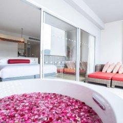 Отель Ramada by Wyndham Phuket Deevana Patong Номер Делюкс с двуспальной кроватью фото 16