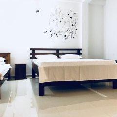 Отель Neem Tree Guest House Номер Делюкс с различными типами кроватей
