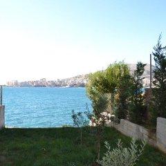 Отель Azzurra Apartments Албания, Саранда - отзывы, цены и фото номеров - забронировать отель Azzurra Apartments онлайн приотельная территория фото 2