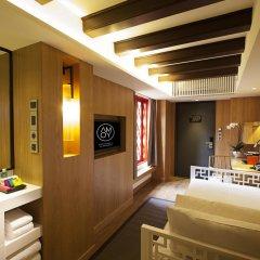 Отель AMOY by Far East Hospitality 4* Номер Делюкс с различными типами кроватей фото 4