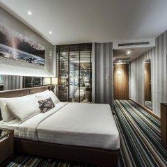 Отель The Continent Bangkok by Compass Hospitality 4* Улучшенный номер с различными типами кроватей фото 7