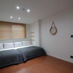 Отель YE'4 Guesthouse 2* Стандартный семейный номер с двуспальной кроватью (общая ванная комната) фото 7