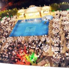 Palmcity Hotel Akhisar Турция, Акхисар - отзывы, цены и фото номеров - забронировать отель Palmcity Hotel Akhisar онлайн бассейн фото 2