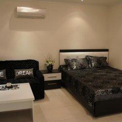 Апартаменты Sea View Studio in Orion Garden комната для гостей фото 5