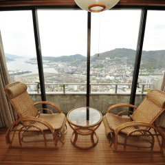 Отель Nisshokan Bettei Koyotei Нагасаки балкон
