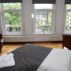 Отель Bridge Inn Нидерланды, Амстердам - отзывы, цены и фото номеров - забронировать отель Bridge Inn онлайн комната для гостей фото 5