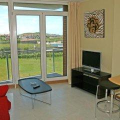 Отель Apartamentos Playa de Portio Испания, Пьелагос - отзывы, цены и фото номеров - забронировать отель Apartamentos Playa de Portio онлайн комната для гостей фото 3