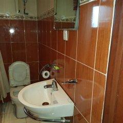 Отель Mangel Hotel And Suites Нигерия, Калабар - отзывы, цены и фото номеров - забронировать отель Mangel Hotel And Suites онлайн ванная