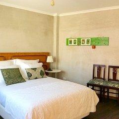 Отель Mercearia d'Alegria Boutique B&B Улучшенный номер двуспальная кровать фото 6