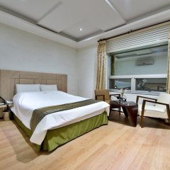 Bellagio Tourist Hotel сейф в номере