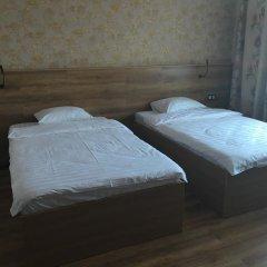 Гостиница Postoyaliy Dvor Inn в Уссурийске отзывы, цены и фото номеров - забронировать гостиницу Postoyaliy Dvor Inn онлайн Уссурийск комната для гостей фото 4