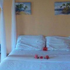 Отель By The Sea Vacation Home And Villa комната для гостей фото 5