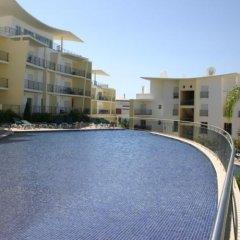 Отель Condominio Encosta Da Orada by Garvetur бассейн