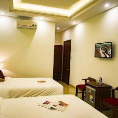 Отель Mi Kha Homestay 3* Улучшенный номер с различными типами кроватей фото 5