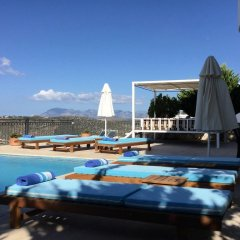Отель Paradise Villas бассейн