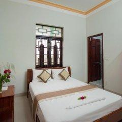 Отель Tra Que Flower Homestay Стандартный номер с двуспальной кроватью фото 11