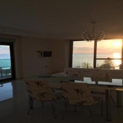 Отель Luxury Apt in Konak Sea Side with a Sea front view and a private beach бассейн