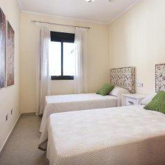 Отель Oasis duplex Ciudad Quesada Рохалес комната для гостей фото 3