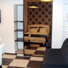 Отель Spot Inn Old Town Apartment Литва, Вильнюс - отзывы, цены и фото номеров - забронировать отель Spot Inn Old Town Apartment онлайн комната для гостей фото 2