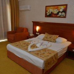 Отель Laphetos Beach Resort & Spa - All Inclusive комната для гостей фото 4