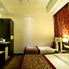 Отель The Prime Balaji Deluxe @ New Delhi Railway Station 3* Номер Делюкс с различными типами кроватей фото 3