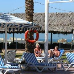 Отель Ras Al Khaimah Hotel ОАЭ, Рас-эль-Хайма - 2 отзыва об отеле, цены и фото номеров - забронировать отель Ras Al Khaimah Hotel онлайн бассейн фото 2