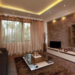 Апартаменты Brown Cottage Apartment комната для гостей фото 3