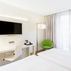 Отель NH Collection Berlin Mitte Am Checkpoint Charlie 4* Стандартный номер с разными типами кроватей фото 11