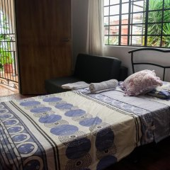 Отель Iguana Boutique Колумбия, Кали - отзывы, цены и фото номеров - забронировать отель Iguana Boutique онлайн комната для гостей фото 3