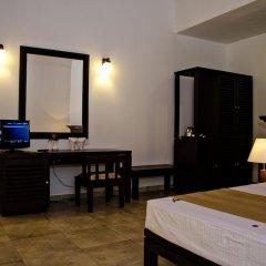 Отель Lotus Paradise Health Resort Шри-Ланка, Ахунгалла - отзывы, цены и фото номеров - забронировать отель Lotus Paradise Health Resort онлайн удобства в номере