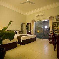 Отель The Moon Villa Hoi An 2* Стандартный семейный номер с различными типами кроватей фото 20
