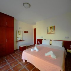 Отель Aselinos Suites 3* Коттедж с различными типами кроватей фото 3