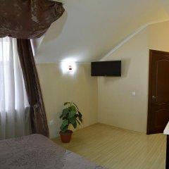 Гостиница Ростов Улучшенный номер двуспальная кровать фото 4